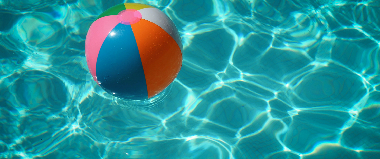 Rolling Meadows Business Buzz Summer 2021 Home Page image with Beach Ball in Pool